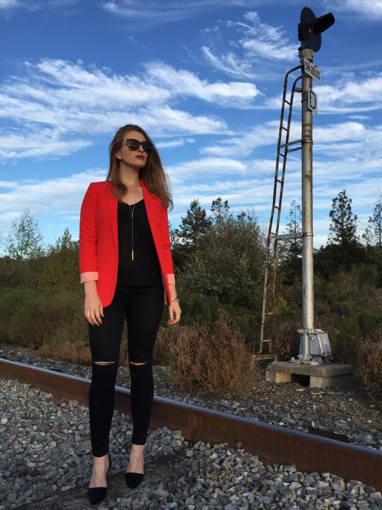 Black skinnies dressed up with a red blazer and heels.